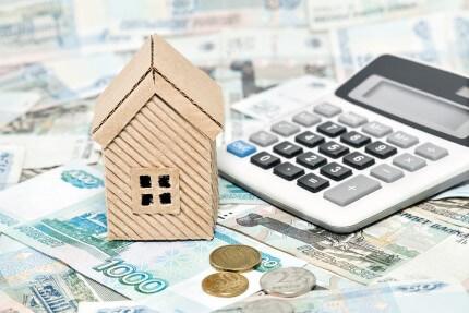דגם של בית עם מחשבון משכנתא